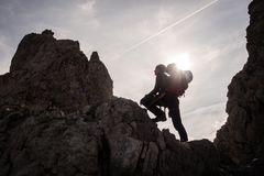 Silhouette of woman climber and mountaineer Royalty Free Stock Photo