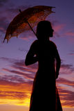 Silhouette of a woman close in the sunset with umbrella Stock Images