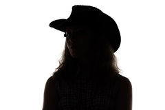 Silhouette of woman in cowboy hat Royalty Free Stock Images
