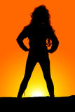 Silhouette woman curly hair stand hands hips Royalty Free Stock Image