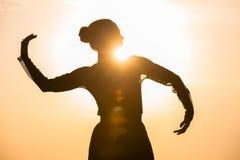 Woman dancing at sunrise Royalty Free Stock Photo