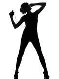 Silhouette woman dancing and listening music Stock Photography
