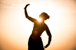 Silhouette of the woman dancing at sunrise Royalty Free Stock Photography