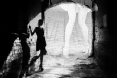 Silhouette of a woman in a dark alley of the city royalty free stock image