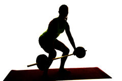Silhouette of a woman deadlifting Stock Photo