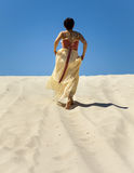 Silhouette of woman in desert Stock Photo