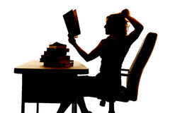 Silhouette woman at desk book pull hair Stock Photos