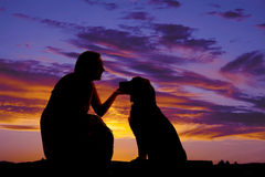 Silhouette woman dog sit Royalty Free Stock Photos