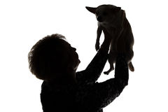 Silhouette of a woman with the dog Royalty Free Stock Photography
