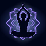 Silhouette of a woman doing yoga exercises. Neon mandala on the background. Vector image. Stock Image