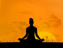 Silhouette of woman doing yoga Stock Photos