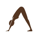 Silhouette of woman doing yoga Stock Image