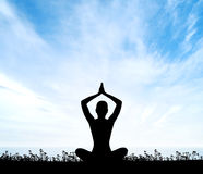 Silhouette of a woman doing yoga Royalty Free Stock Images