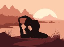 Silhouette of woman doing yoga in mountains Stock Photography