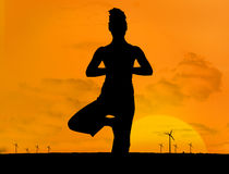 Silhouette of woman doing yoga outdoors Stock Image