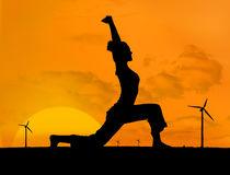Silhouette of woman doing yoga with wind turbines Royalty Free Stock Photos