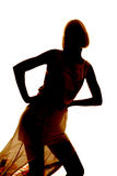 Silhouette of a woman in dress lean forward Stock Images