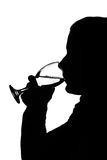 Silhouette of a woman drinking Royalty Free Stock Photo