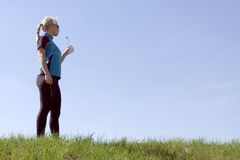 Silhouette of woman drinking water after running. Outdoors Royalty Free Stock Photography