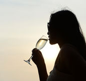 Silhouette of woman drinking Stock Photos