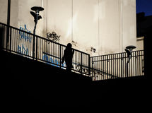 Silhouette of a woman on elevated walkway. Stock Photo