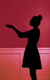 Silhouette of woman extending the hands Stock Image
