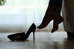 Silhouette of woman feet resting Stock Images