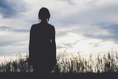 Silhouette of woman in field Royalty Free Stock Images