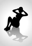 Silhouette of a woman figure doing sit up Royalty Free Stock Photography