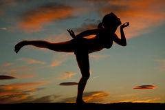 Silhouette woman fitness leg out hand chin Stock Images