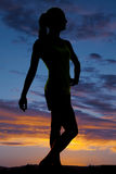 Silhouette of a woman fitness posing Stock Images