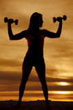 Silhouette woman fitness weights flex Royalty Free Stock Image
