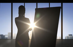 Silhouette of woman with flipboard over office Royalty Free Stock Photo