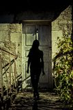 Silhouette of a Woman at a door royalty free stock images