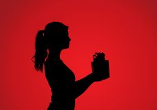 Silhouette of woman with gift Stock Photos