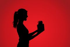 Silhouette of woman with gift Stock Image