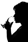 Silhouette of a woman with glass Royalty Free Stock Photos