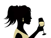 Silhouette of a woman with a glass Stock Photo