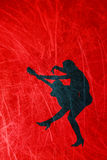 Silhouette of a woman with a guitar on a grunge, red background Stock Photo