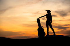 Silhouette of woman with guitar Royalty Free Stock Image