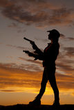 Silhouette woman guns side point Royalty Free Stock Photography