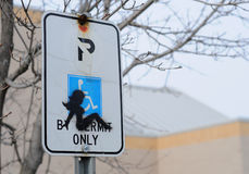 Silhouette of woman on handicap parking sign Stock Photography