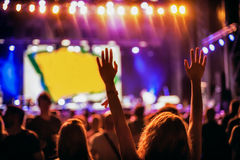 Silhouette of woman hands and arms at concert festival party Stock Photography