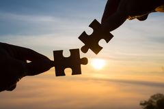 Silhouette Woman hands connecting couple puzzle piece against sunrise, Business solutions, target, success, goals and strategy co. Ncepts stock image