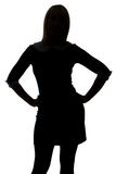 Silhouette of woman with hands on hip Stock Photo