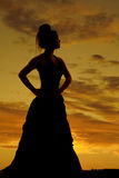 Silhouette woman hands hips big dress Stock Images