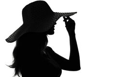 Silhouette of a woman in a hat Stock Photo