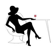Silhouette of woman with hat drinking white wine Royalty Free Stock Photography