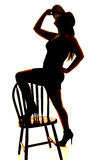 Silhouette of woman hat foot on chair Royalty Free Stock Photos