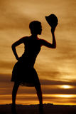 Silhouette woman with hat in hand Stock Photography